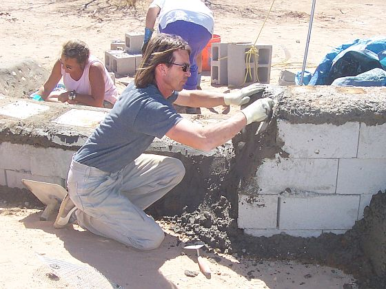 Putting mortar over the blocks